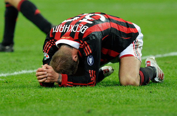Beckham in pain after sustaining an injury playing for AC Milan.