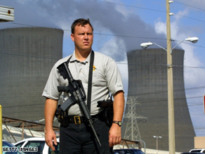 A Citrus County Sheriff officer stands guard at the entrance to the Florida Power corp. nuclear power plant.