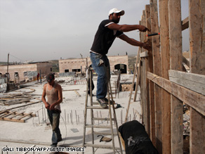 Palestinian laborers work on a construction site in east Jerusalem. VP Biden has criticized Israel's decision to approve construction of 1,600 new homes for Jewish settlers in east Jerusalem.