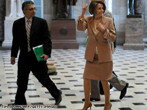 House Speaker Pelosi walks through the Capitol. The House is expected to cast its verdict on a Senate bill Sunday. A 'yes' vote would enshrine into law comprehensive health care reform, bringing coverage to 32 million Americans who currently lack insurance.