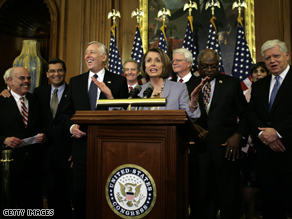 House Speaker Nancy Pelosi, backed by fellow Democrats, speaks at a press conference after the successful passage of health care reform in the House.