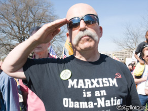 A supporter of the Tea Party movement salutes at the reciting of the Pledge of Allegiance during a demonstration outside the US Capitol on March 20, 2010.