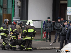 Russian police carry equipment and stand guard near the Lubyanka metro station in Moscow on March 29, 2010 after two explosions.