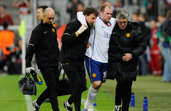 Wayne Rooney limps out of Manchester United's clash with Bayern Munich.
