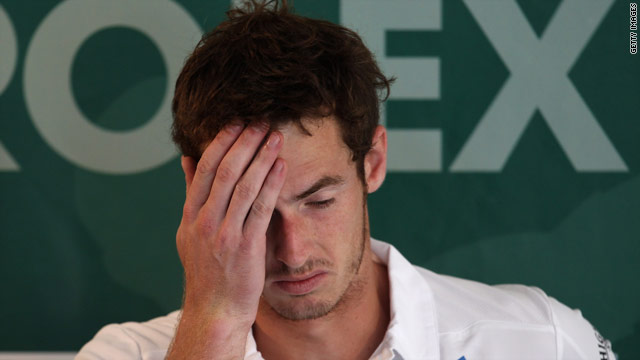 Murray cut a forlorn figure after his defeat at the Monte Carlo Masters.
