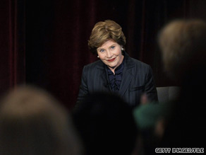 Former First Lady Laura Bush suggests in her forthcoming memoir that she, her husband, and several aides were poisoned during a 2007 visit to Germany for the G8 summit.