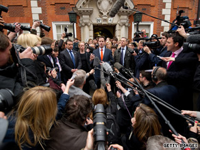 Reporters mob Liberal Democrat leader Nick Clegg after no party won an outright majority in Thursday's UK election.