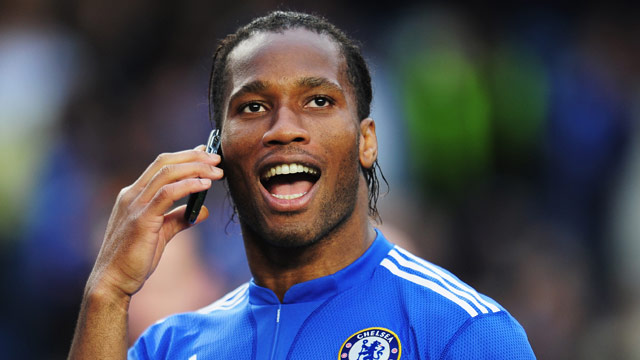 Drogba enjoys the atmosphere after his side Chelsea had clinched the Premier League title on Sunday.