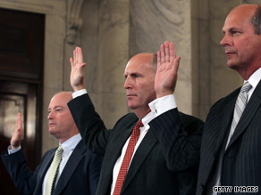 Lamar McKay (far left), president and chairman of BP America; Steven Newman (center), president and CEO of Transocean; and Tim Probert (right) president of global business lines and chief health, safety and environmental officer for Halliburton are sworn in before a Senate committee hearing Tuesday.