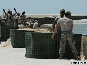 Members of the Alabama National Guard build a sea wall on Dauphin Island in anticipation of the oil slick coming ashore.