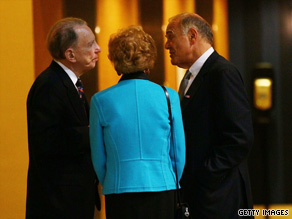 Gov. Rendell, right, huddled with Sen. Specter, left, and Specter's wife on Tuesday in Philadelphia.
