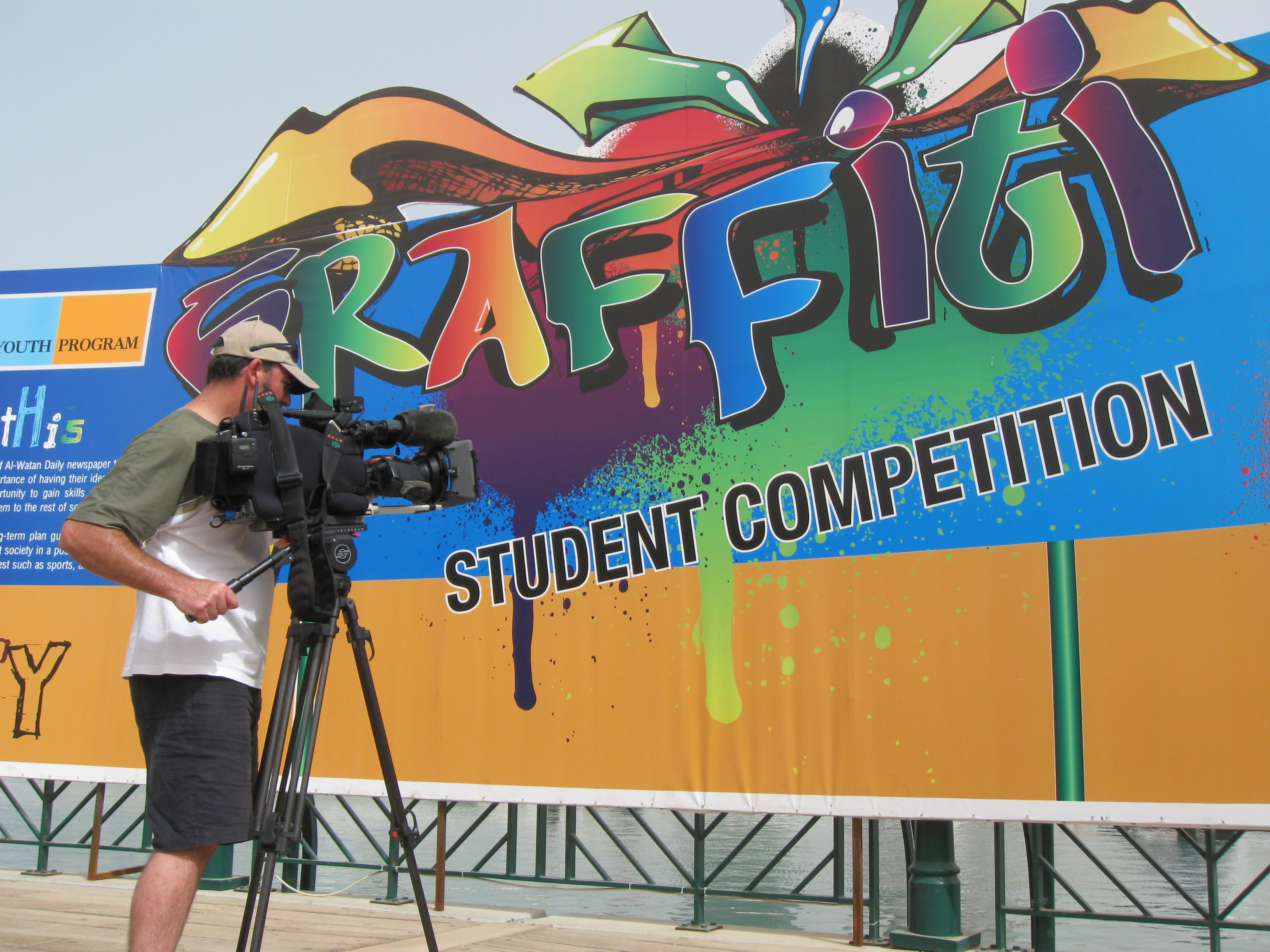 Cameraman James Stacey getting footage of the Graffiti Student Competition, part of the Al-Watan Daily Youth Initiative.