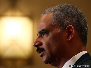 Attorney General Eric Holder vowed the Justice Department would continue 'working tirelessly to combat terrorism.'