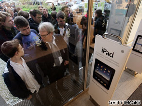 Shoppers wait to purchase their new iPad.