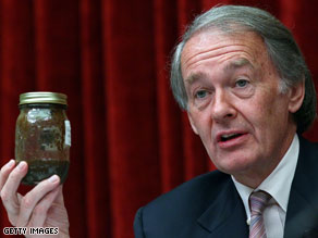 Ed Markey holds up a container filled with oil taken from the Gulf of Mexico.