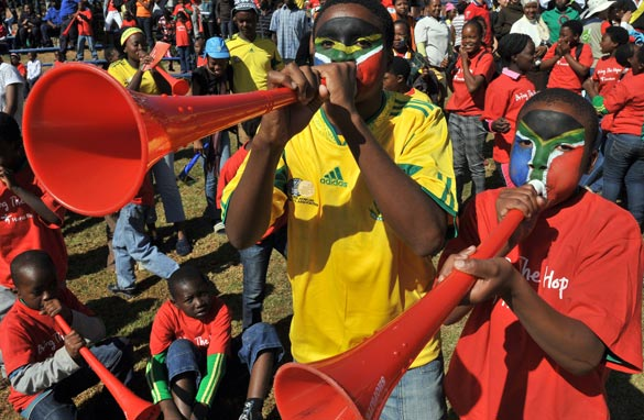 South African children blow their vuvuzelas at a pre-World Cup charity event in Pretoria. AFP/Getty Images.