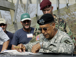 Lt. Gen. Russel Honoré looks over a map of hurricane damage in Louisiana, 2005.