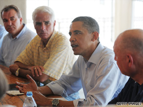 President Obama, Gov. Charlie Crist, and Adm. Thad Allen at a briefing with local officials in Pensacola, Florida Tuesday. A new poll indicates nearly half of the public disapproves of how Obama's handling the oil spill.