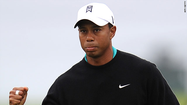 Woods pumps his first after picking up a rare birdie in his first round at Pebble Beach.