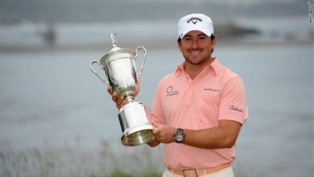 Graeme McDowell proudly holds the U.S. Open title after his first victory in a major.