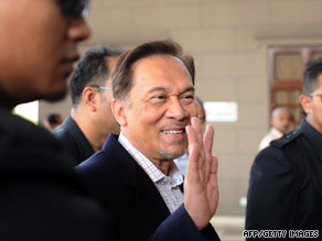 Anwar Ibrahim waves as he walks into court in Kuala Lumpur on May 31.