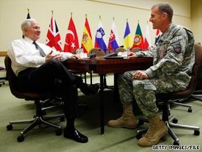 Gen. Stanley McChrystal (right) met with Defense Secretary Robert Gates June 10 in Brussels, Belgium.