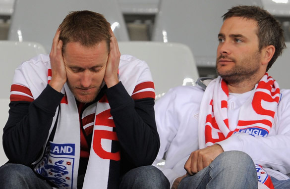England fans show their disappointment following the 0-0 draw with Algeria (Getty Images).
