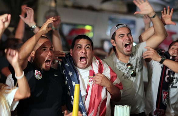 USA fans in Miami celebrate their teams World Cup victory against Algeria and further progress in the tournament. (Getty)