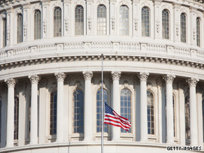 The flag flies at half staff at the Capitol building on Monday following the death of Sen. Robert Byrd. There is confusion about the process that will be used to fill his seat.