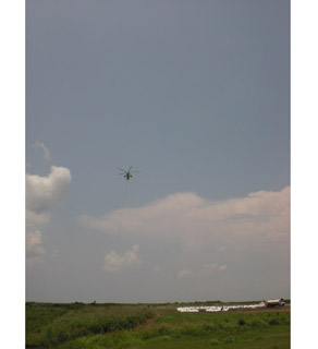Helicopter airlift in progress, Plaquemines Parish, Louisiana