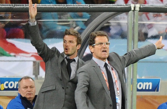 David Beckham was welcomed onto the England coaching bench in South Africa by Fabio Capello. (AFP/Getty)