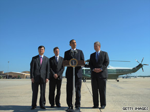 President Obama speaks about the monthly employment numbers flanked by Treasury Secretary Tim Geithner, Commerce Gary Locke, and Agriculture Tom Vilsack at Andrews Air Force Base.