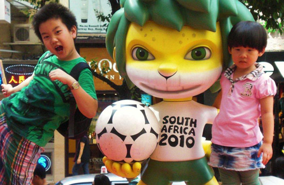 Children in Hong Kong pose with Zakumi, the 2010 World Cup mascot, before Sunday&#039;s final.