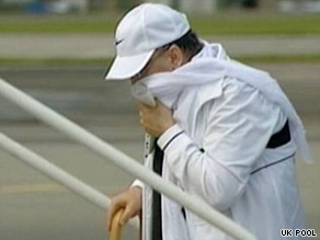 Convicted Pan Am bomber Abdelbaset al Megrahi boards a plane in Scotland to make his final trip home to Libya on August 20.