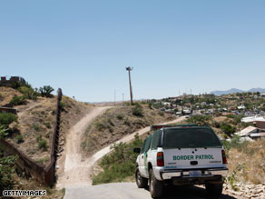 A Border Patrol agent patrols the border in Nogales, Arizona.