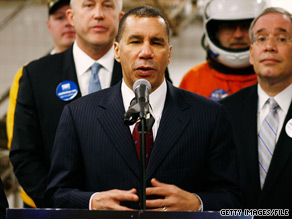  New York Gov. David Paterson should not face charges involving alleged attempts to cover up domestic violence claims against a former aide, according to a report issued Wednesday.