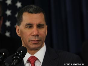 A former aide to New York Gov. David Paterson has been charged with assault.
