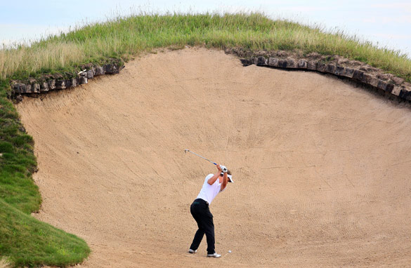 Luke Donald plays his way out of a bunker at Whistling Straits at the PGA Championship on Friday. (Getty Images)