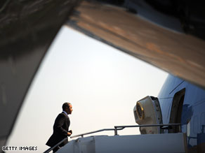 President Obama boarded Air Force One Tuesday in Seattle, Washington. A pair of sonic booms were heard and felt from two fighter jets scrambled when a plane entered restricted airspace while Obama was on the ground.