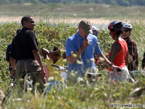 President Obama and his family go for a bike ride along Lobsterville beach on Martha's Vineyard in August 2009.