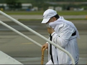 Abdelbeset Ali Mohmed al Megrahi, the man convicted of the Pan Am 103 bombing 1988  boards a plane in  Scotland to make his final trip home Libya,  Thursday August 20,  2009.