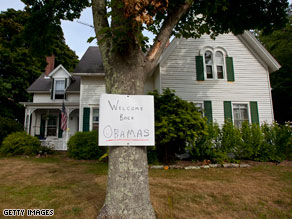 A sign posted on a tree near the Obama&#039;s vacation location reads: &#039;Welcome back Obamas.&#039;