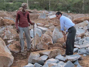 This man shows me how he breaks rocks with an 18-kg hammer in 40C heat for $0.02 per square foot of crushed stone.