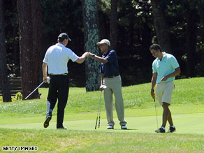 President Obama enjoying a round of golf.