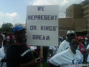  A man holds a sign at the Restoring the Dream rally in Washington on Saturday.