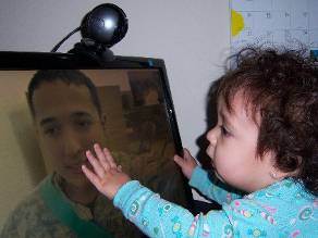 9-month old Alanna 'touching' her father through Skype while he is serving in Iraq. He's spent more time with Alanna over Skype than he has in person.