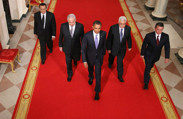 The original photo showed U.S. President Barack Obama leading Middle East leaders during peace talks.