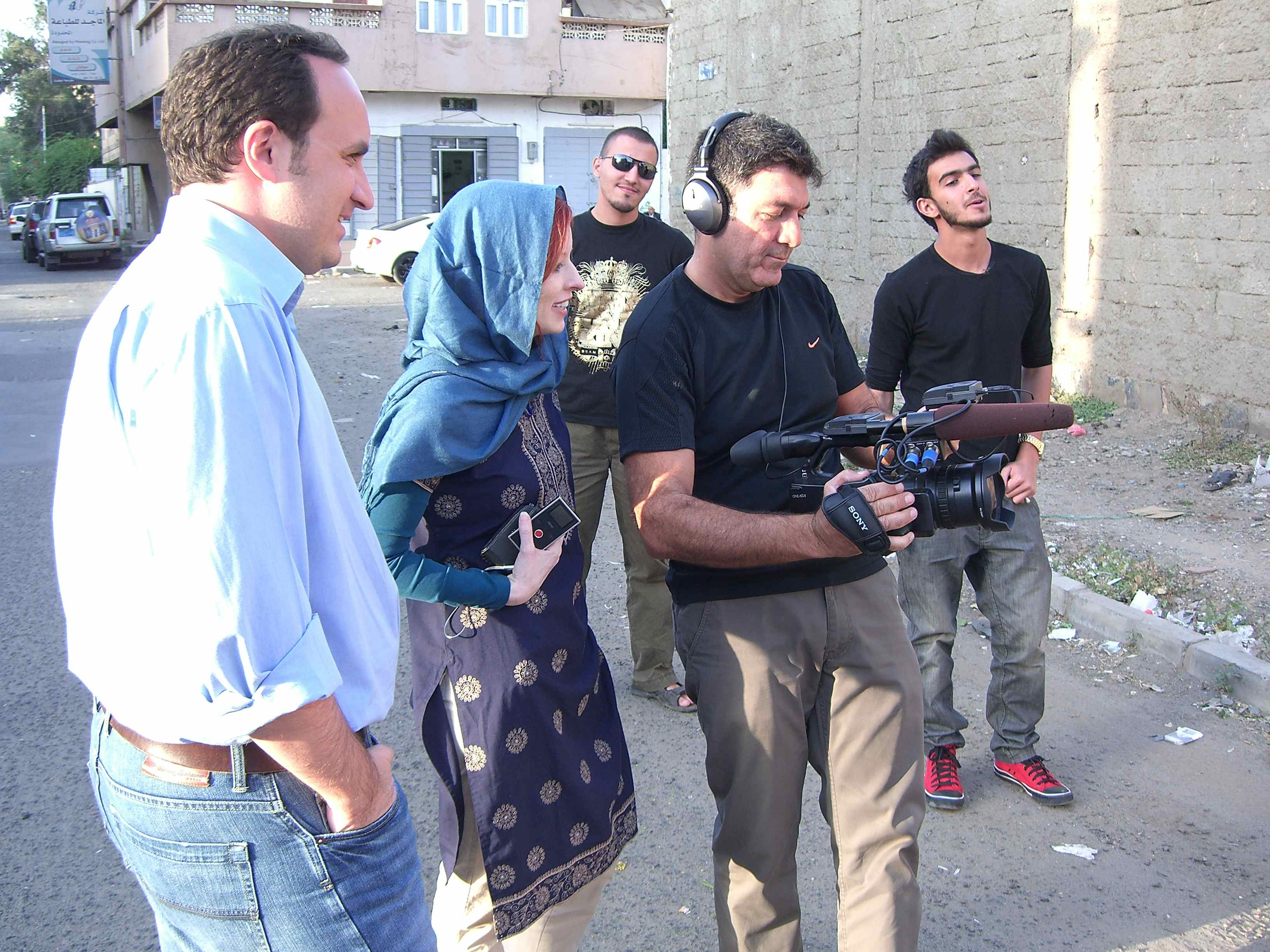 Photo CNN/Dane Kenny. Mohammed, Farhad and Gena shooting outside the Yemen Music House that houses a recording studio.