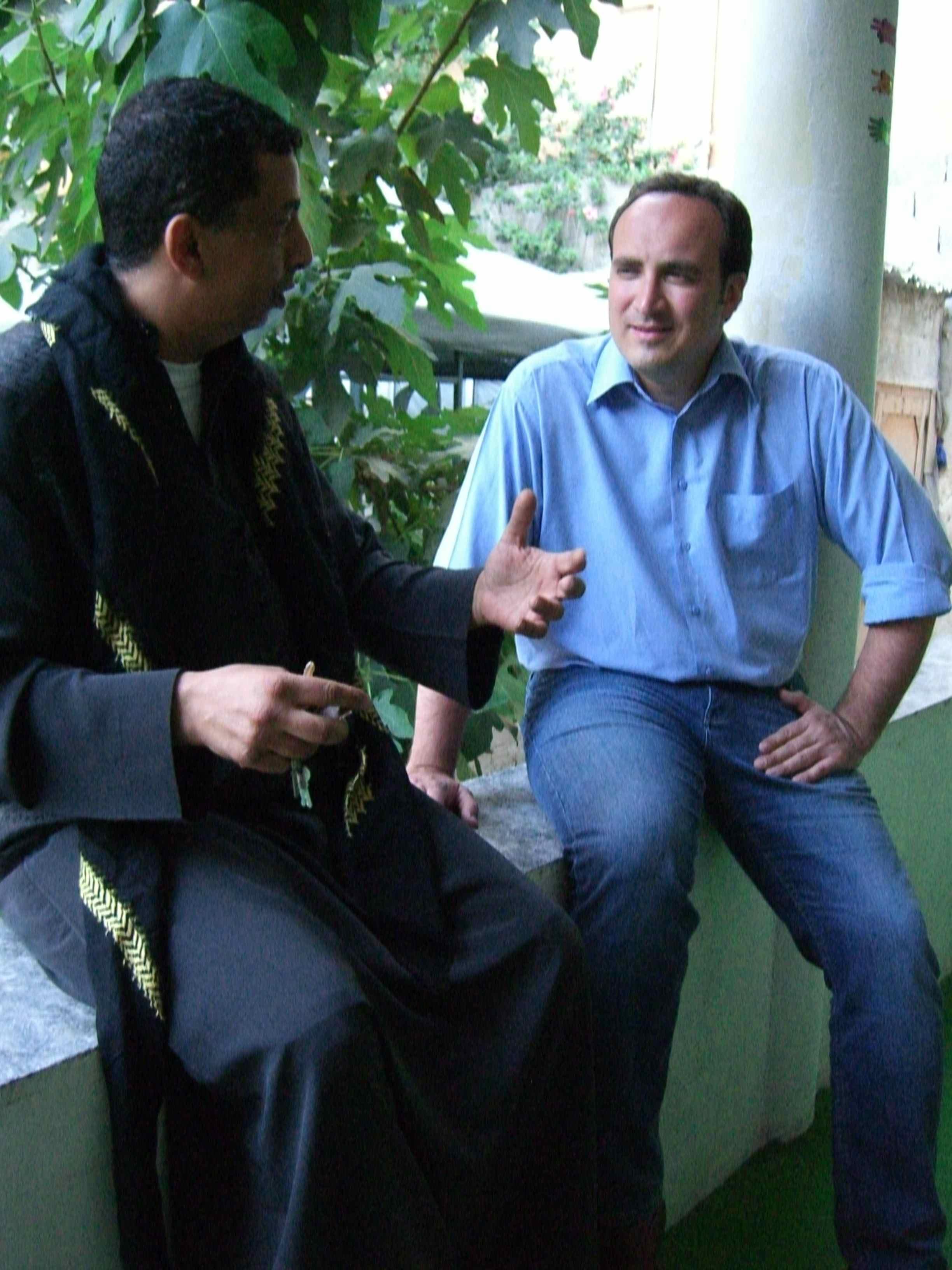 Photo CNN/Dane Kenny. Mohammed Jamjoom talking to rapper AJ, the self-styled Godfather of Yemeni Hip Hop.