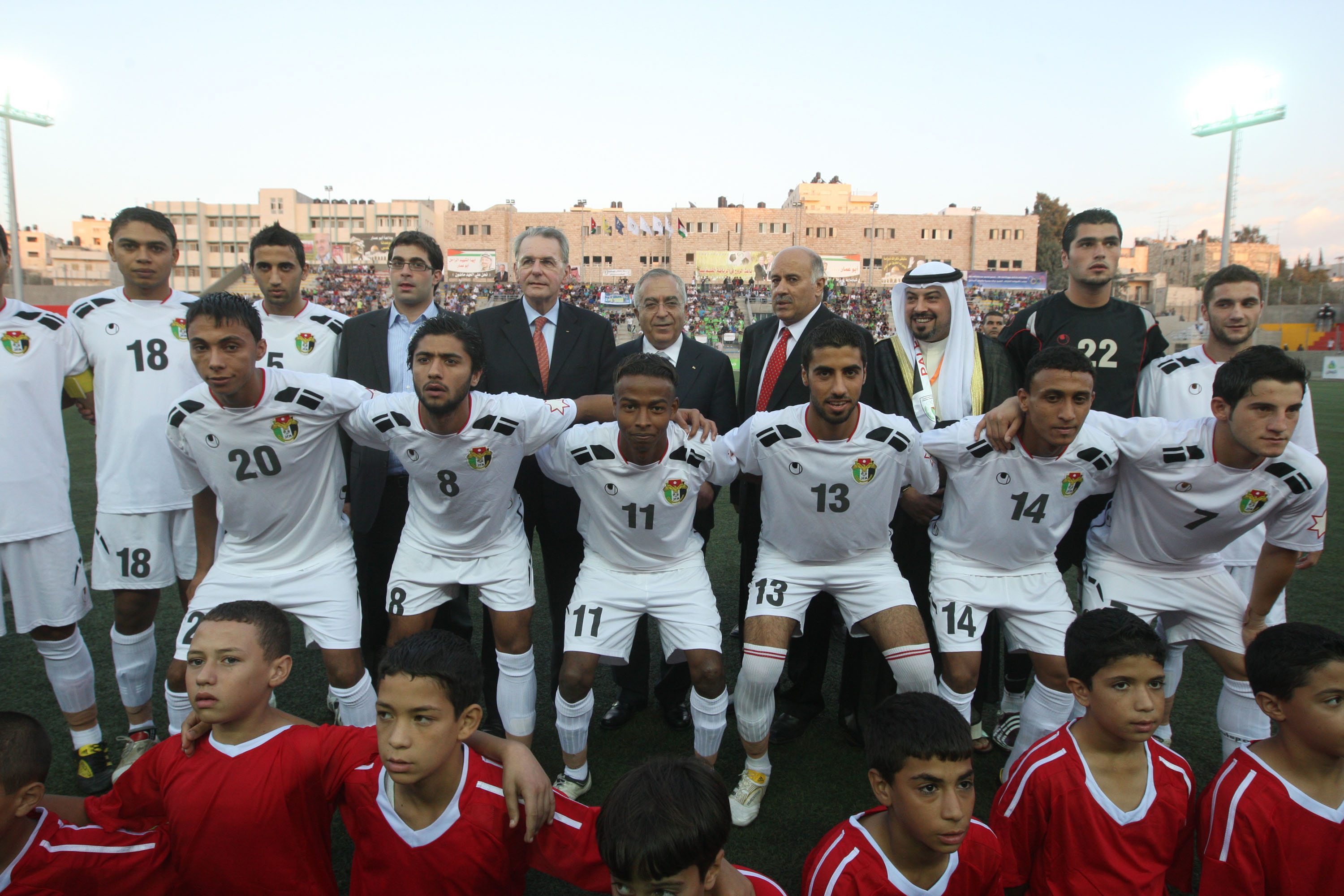 IOC Chief Jacques Rogge and Palestinian Authority Prime Minister Salam Fayyad at West Bank football match (Mustafa Abu Dayeh/Palestinian Authority PM Office)